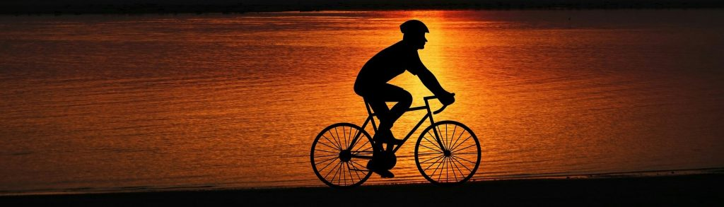 Biking under the Sunset | Breast Cancer Car Donations