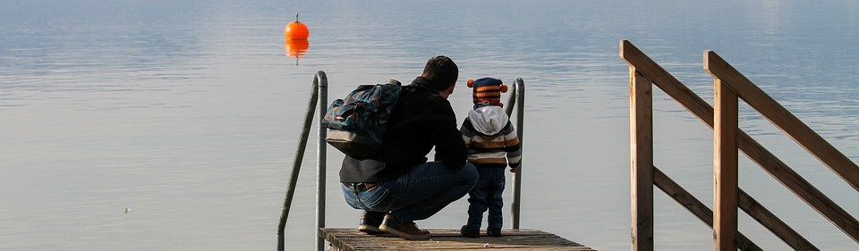 A Father And His Child Overlooking a lake - CarDonations4Cancer.org