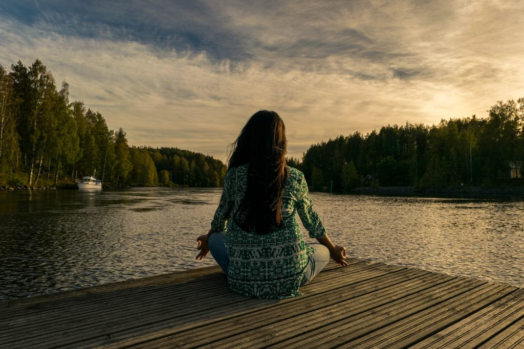 Woman Relaxing on a River Dock | Breast Cancer Car Donations