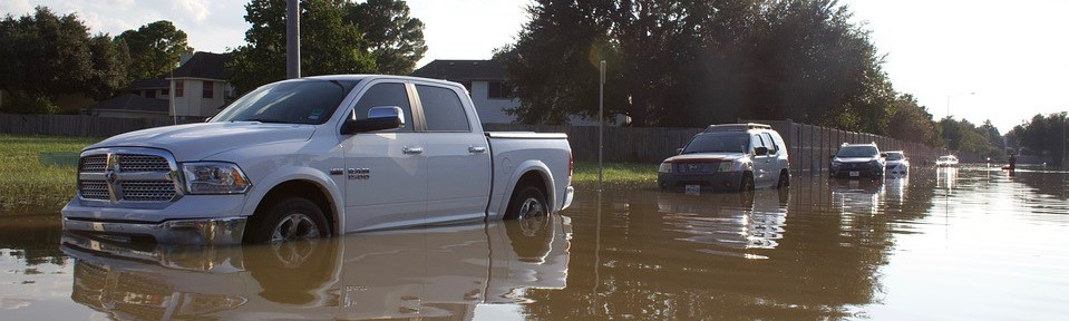 Cars Along a Flooded Street | Breast Cancer Car Donations