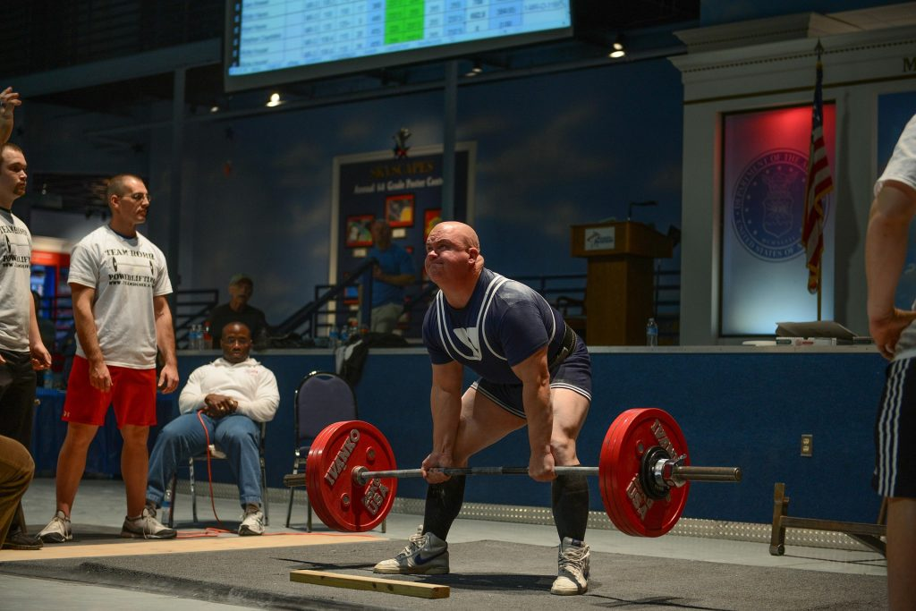 Man trying to beat the record on Weightlifting | Breast Cancer Car Donations