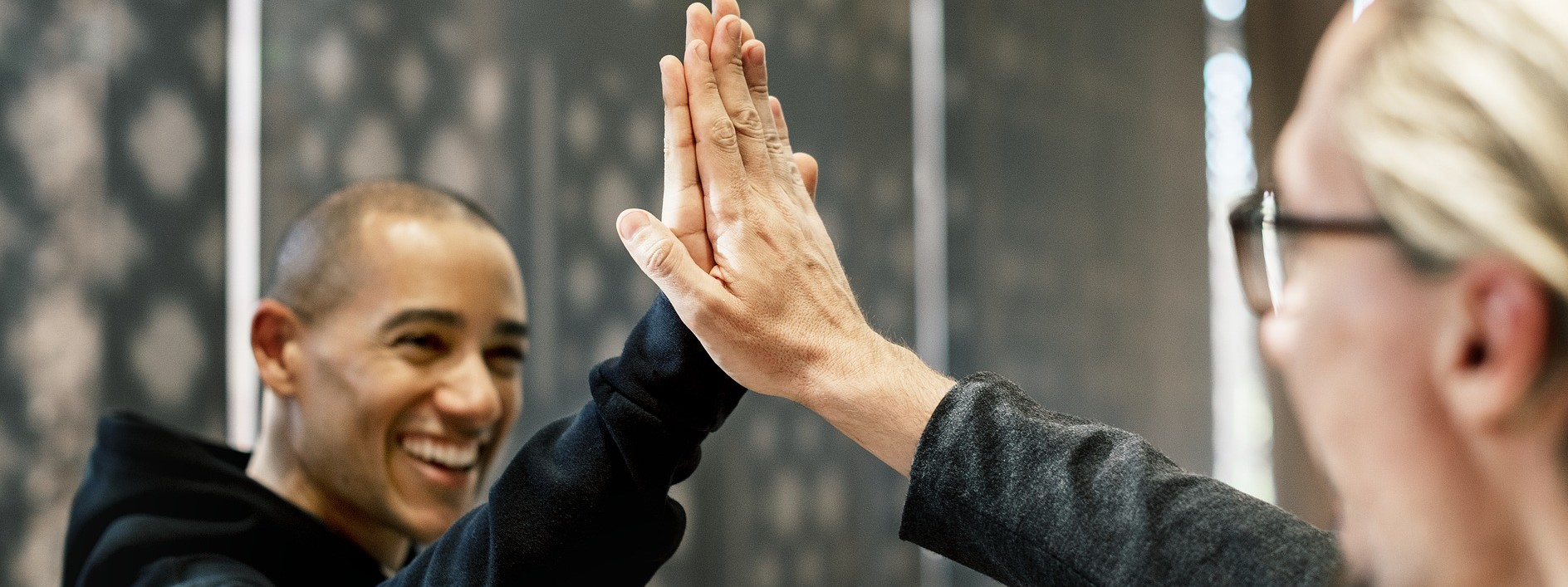 High Five to a colleague this International Day for Tolerance | Breast Cancer Car Donations