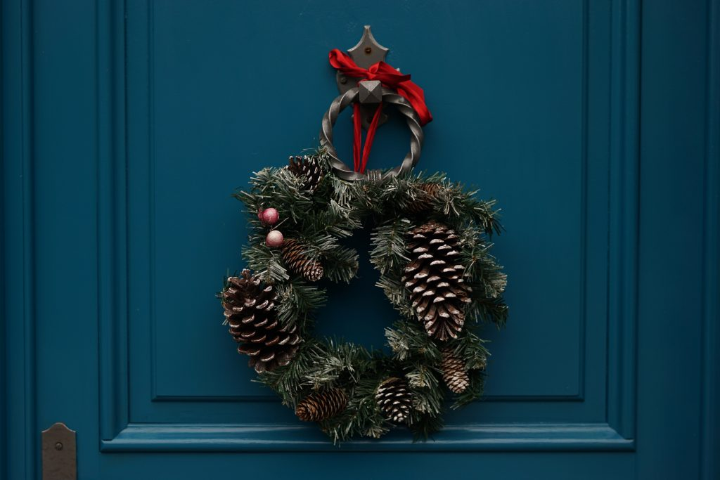 Wreath Hanging on a Door this Christmas | Breast Cancer Car Donations