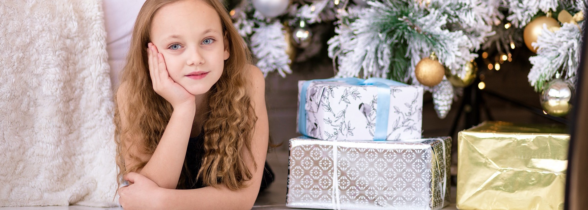 Girl with Christmas Boxes | Breast Cancer Car Donations