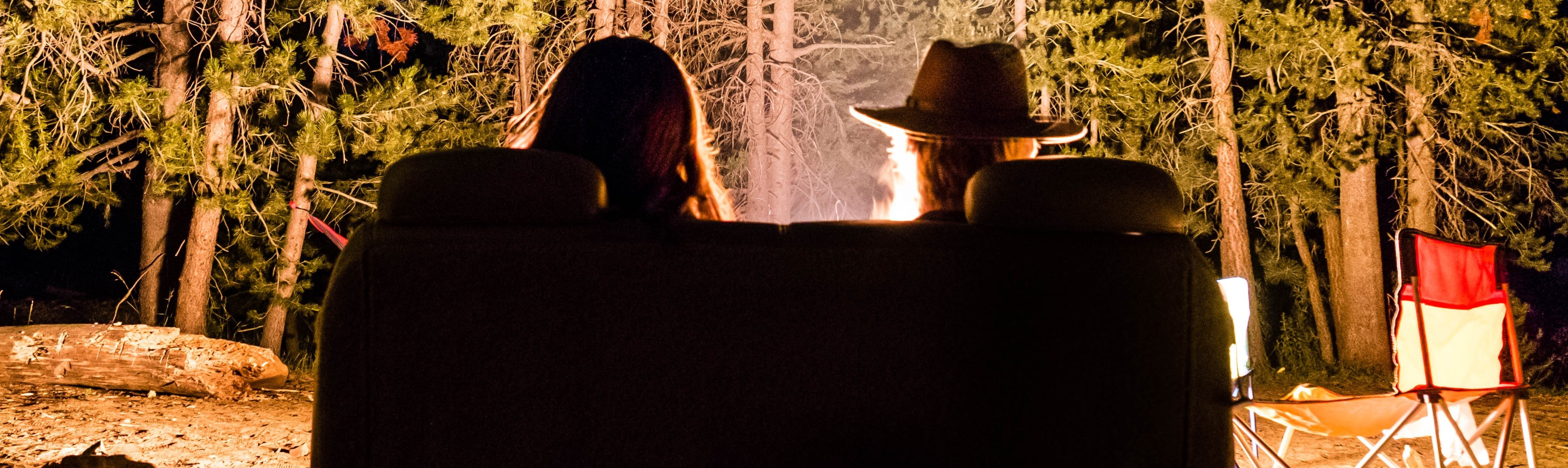 Couple in front of a Campfire | Breast Cancer Car Donations