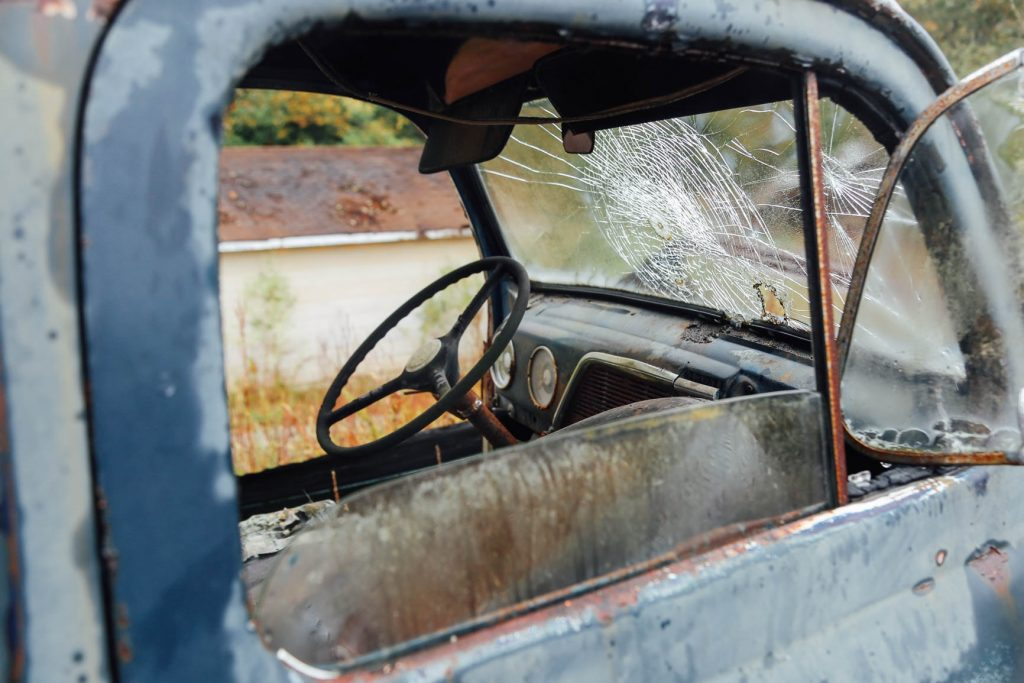 Oldtimer Car with a Broken Glass   Breast Cancer Car Donations