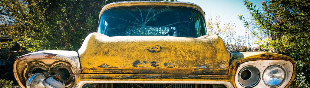 Oldtimer Chevy with a Broken Glass   Breast Cancer Car Donations