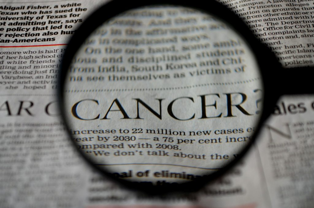 Cancer Issue on a Newspaper Headline   Breast Cancer Car Donations
