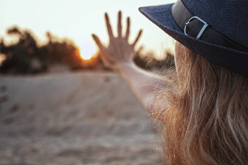 Woman Gesturing Five on a Sunset | Breast Cancer Car Donations