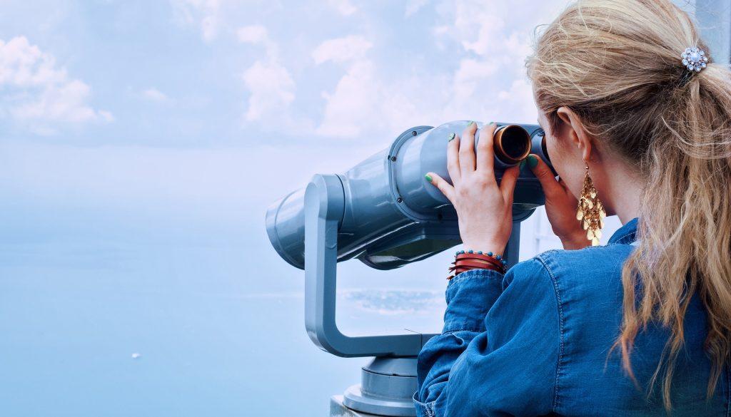 Girl on Binoculars | Breast Cancer Car Donations