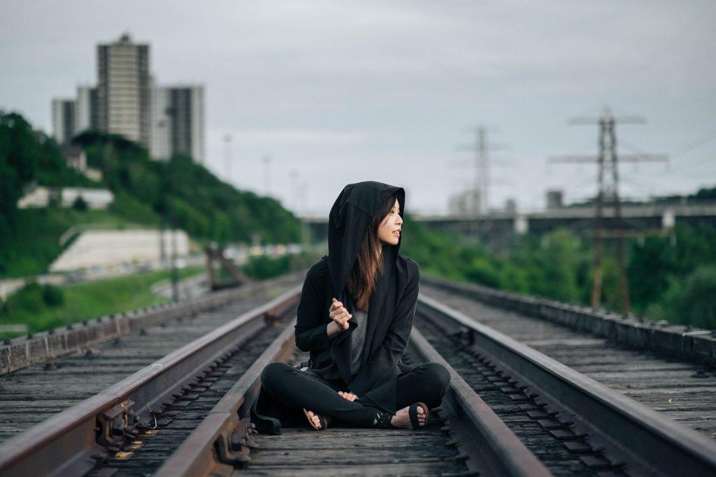 Woman Sitting on a Railway | Breast Cancer Car Donations