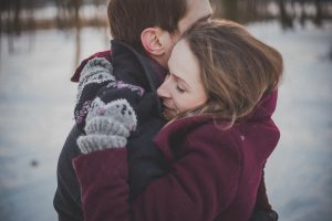 Couple in Snowy Outdoors | Breast Cancer Car Donations