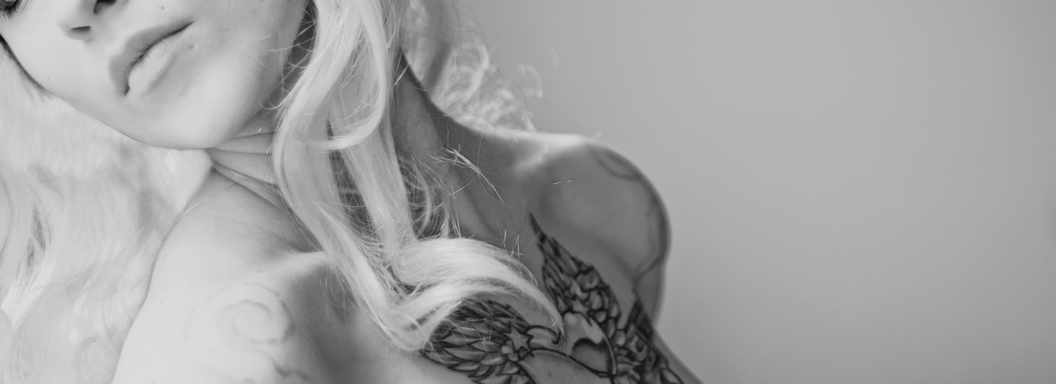 Woman with Tattoo | Breast Cancer Car Donations