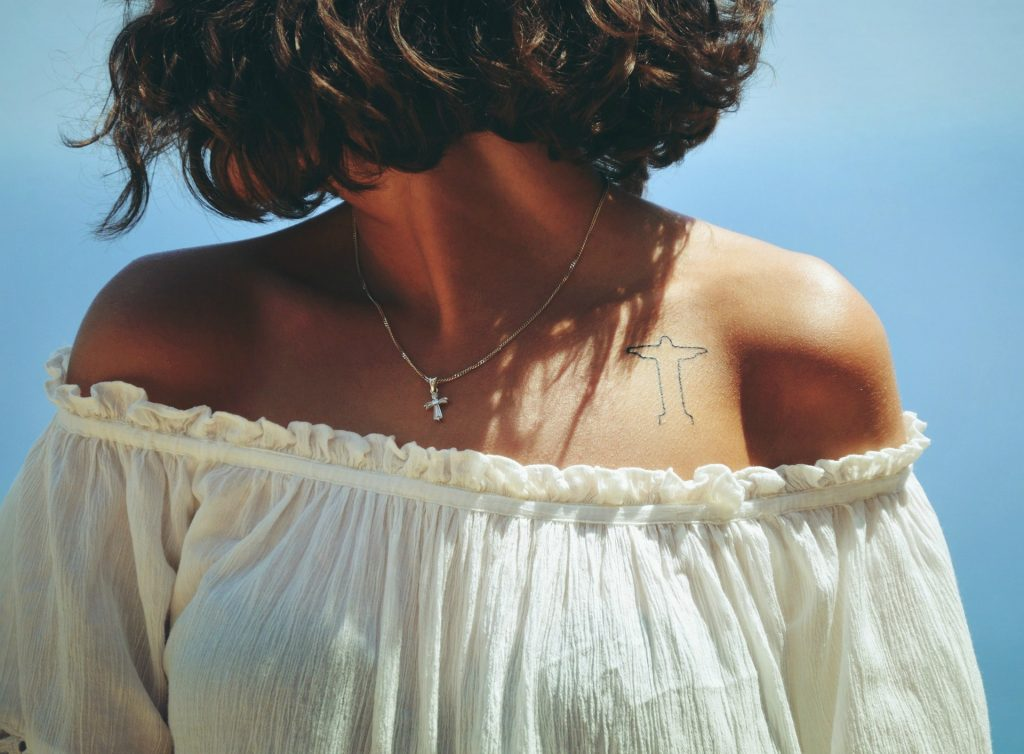 Woman with Christ the Redeemer Tattoo | Breast Cancer Car Donations