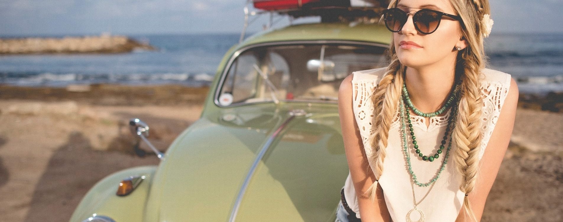 Woman with a Green Oldtimer Beetle | Breast Cancer Car Donations