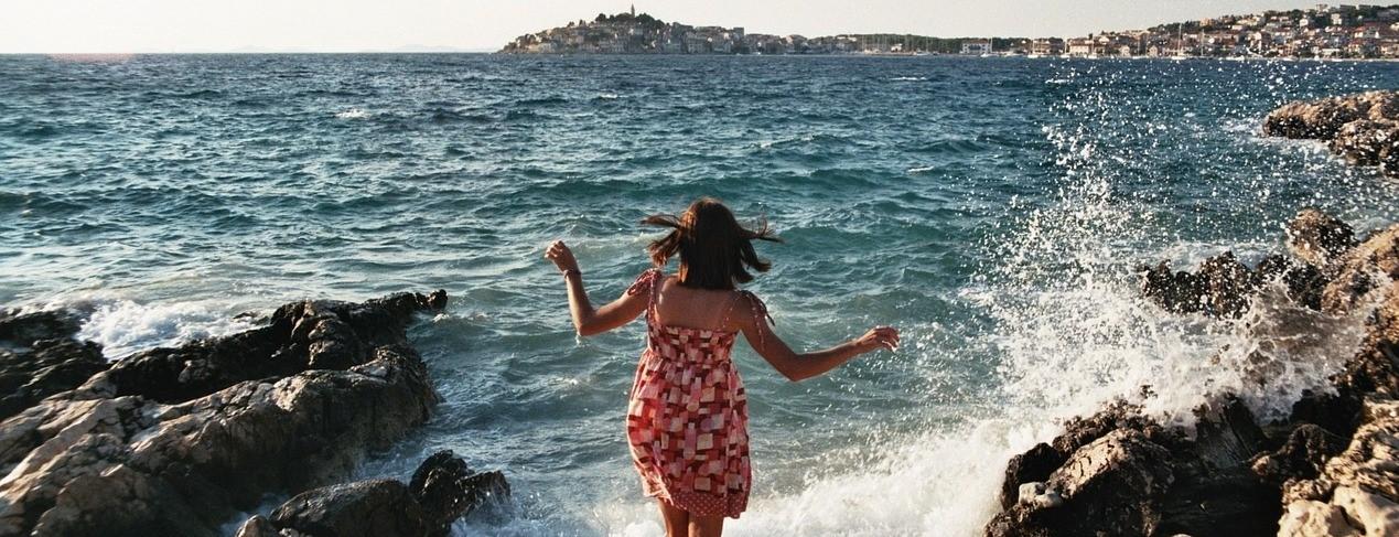 Woman Enjoying Summer Splash | Breast Cancer Car Donations