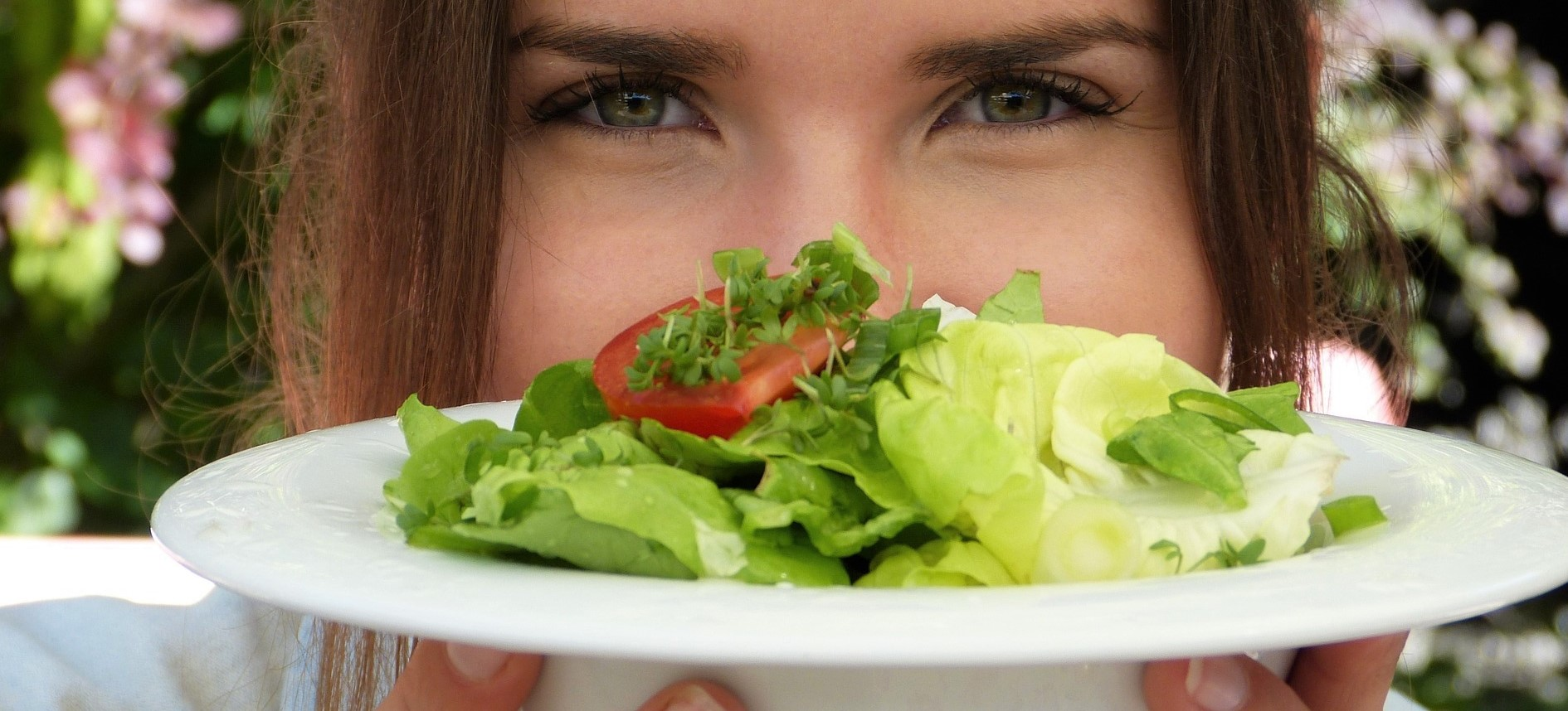 Woman Eating Healthy Salad | Breast Cancer Car Donations