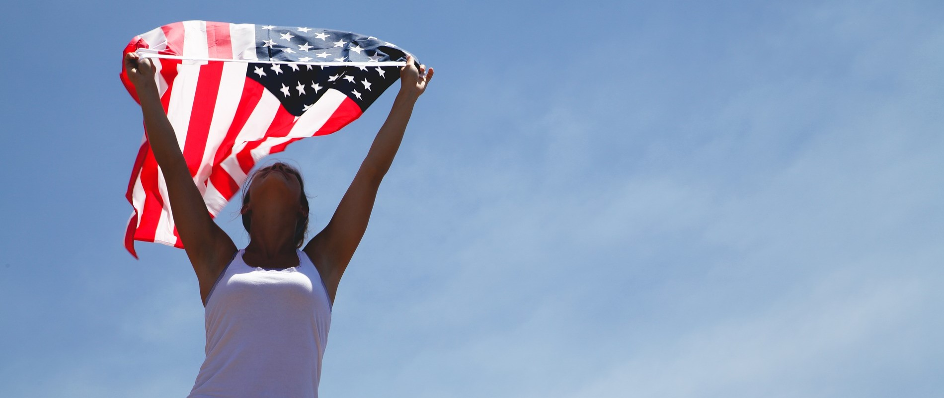 Woman Holding US Flag | Breast Cancer Car Donations