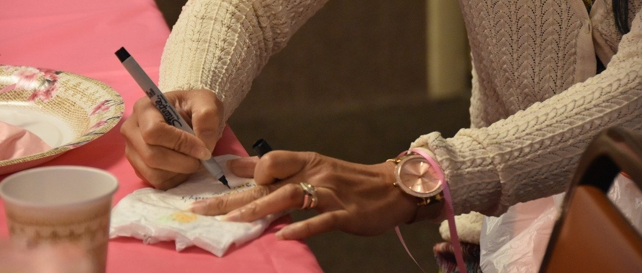 Woman Writing a Letter | Breast Cancer Car Donations