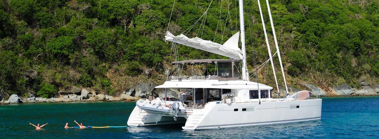 Catamaran Sitting on Waters | Breast Cancer Car Donations