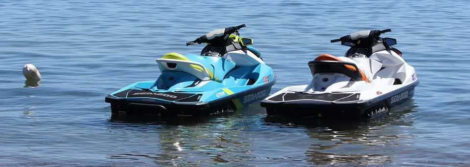 Personal Watercrafts Sitting on the Waters | Breast Cancer Car Donations