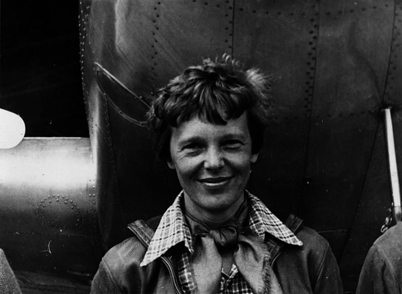 Amelia Earhart Standing Under an Airplane | Breast Cancer Car Donations