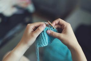 A Person Knitting | Breast Cancer Car Donations