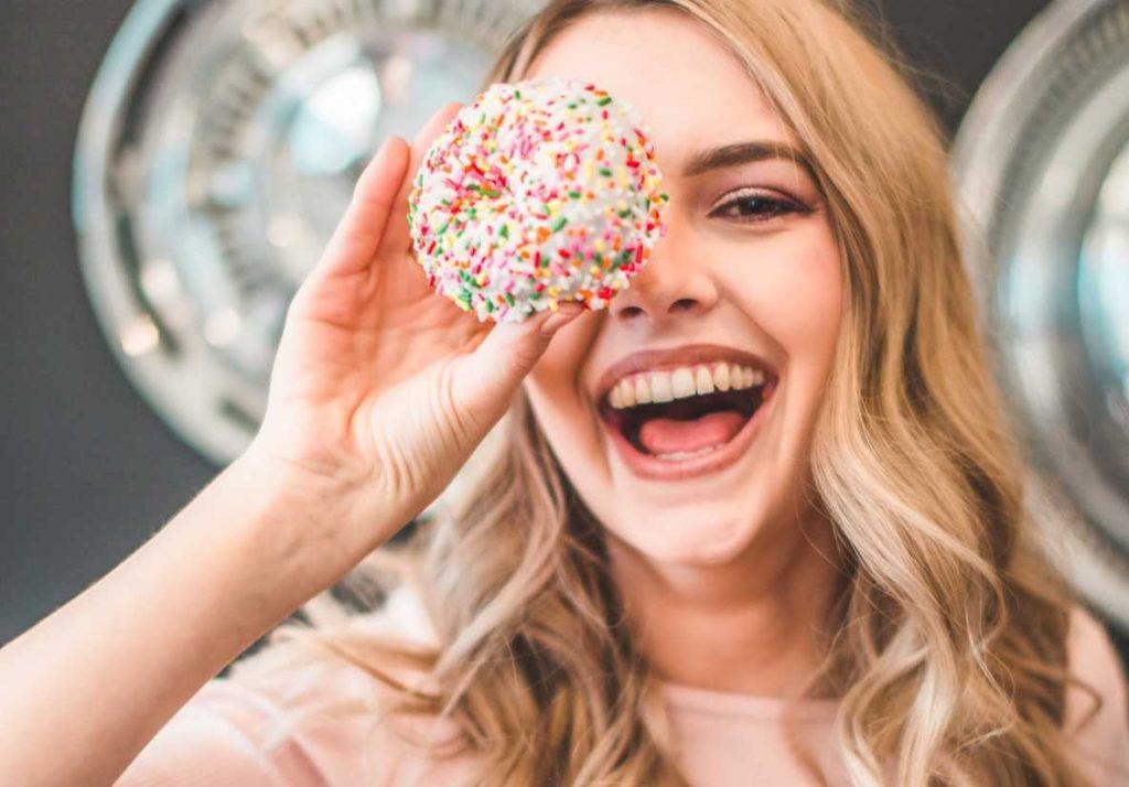 Person Enjoying Doughnut | Breast Cancer Car Donations