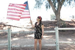 Woman Raising the US Flag | Breast Cancer Car Donations