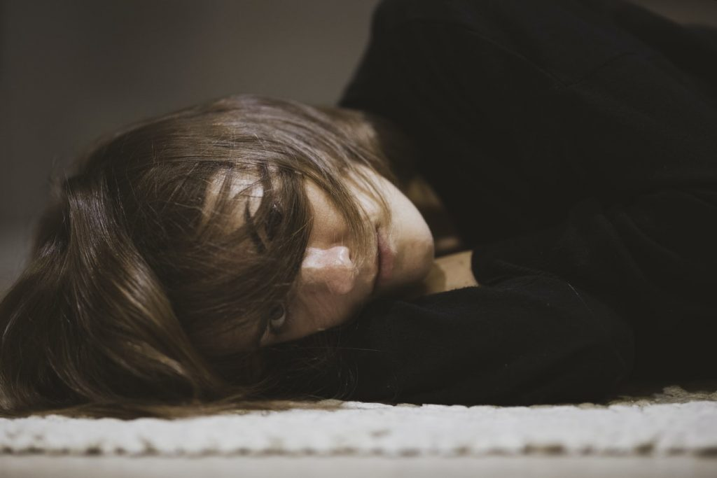 Bored Woman Lying on the Floor   Breast Cancer Car Donations