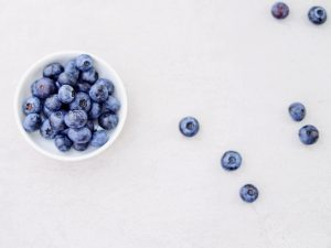 Blueberries on a White Table | Breast Cancer Car Donations