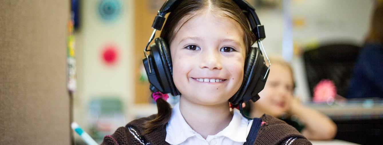 Little Student Wearing Headphones | Breast Cancer Car Donations