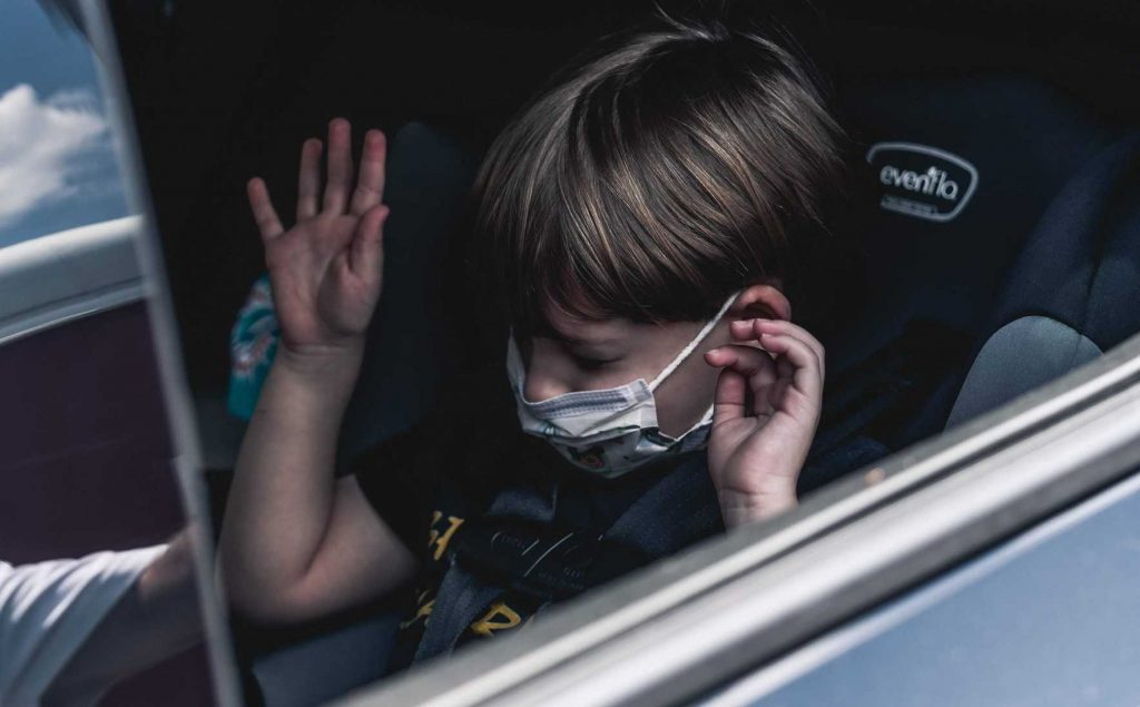 Kid Wearing Mask in a Car   Breast Cancer Car Donations