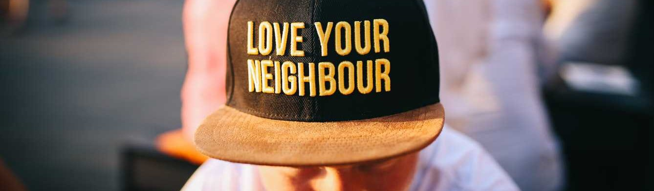 Person Wears Love Your Neighbor Cap | Breast Cancer Car Donations