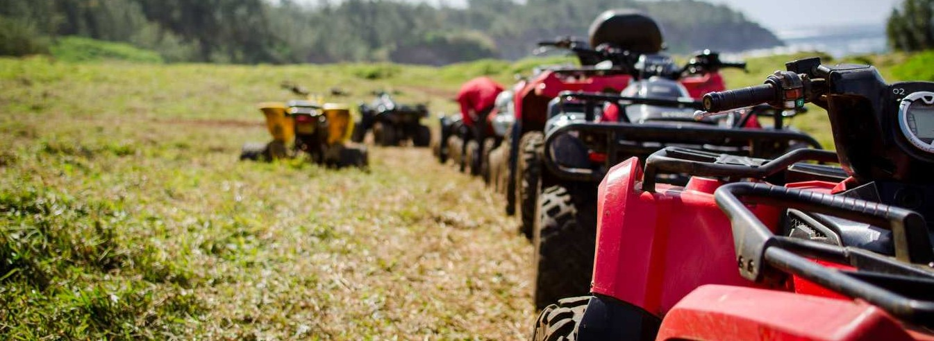 Parked ATVs Outdoors | Breast Cancer Car Donations