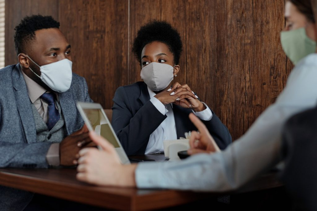 People in a Meeting Wearing Face Masks | Breast Cancer Car Donations