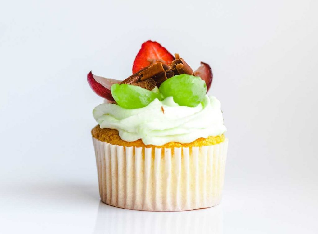 White and Yellow Cupcake With Fruit Toppings   Breast Cancer Car Donations