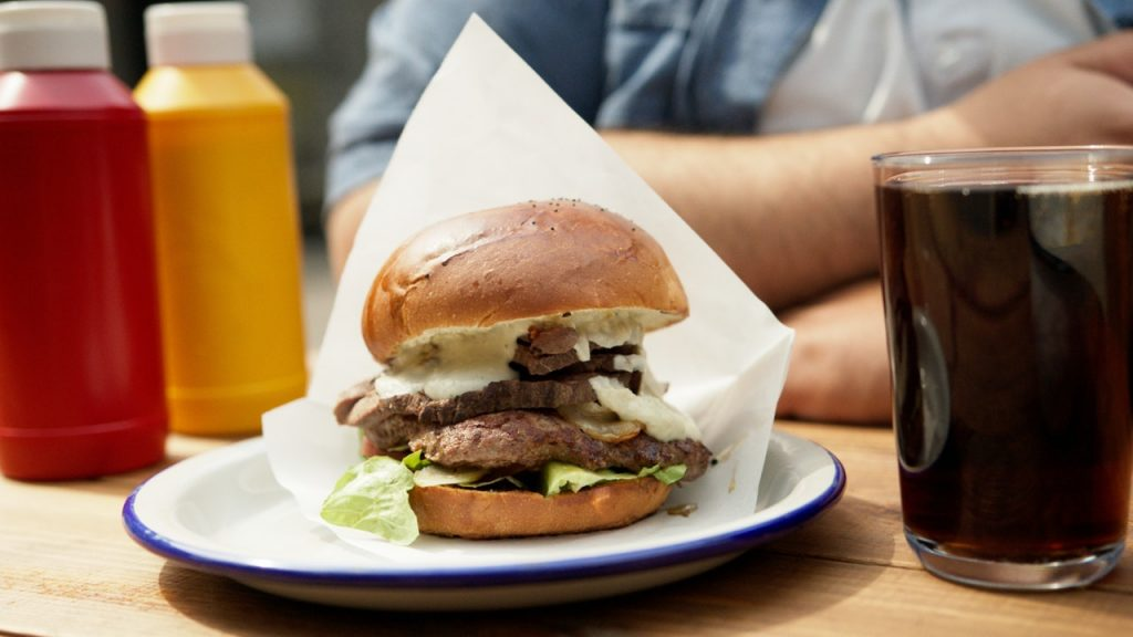Burger With Lettuce and Cheese on White Paper | Breast Cancer Car Donations