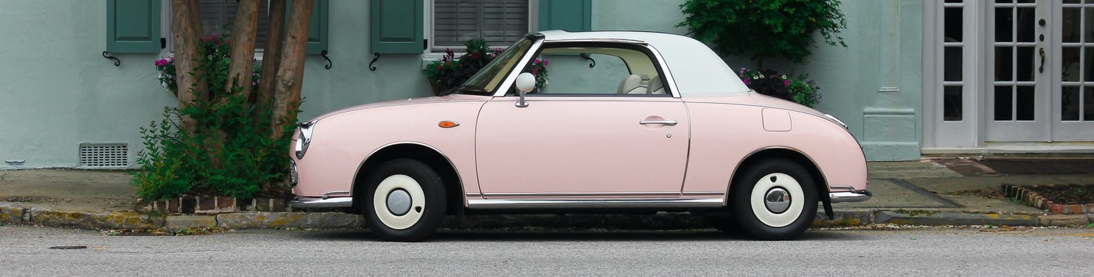 Pink Car Parked on a Street | Breast Cancer Car Donations