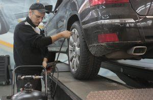 Car Maintenance in a Garage   Breast Cancer Car Donations