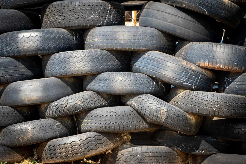 Old Car Tires Piled Up | Breast Cancer Car Donations
