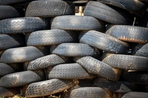 Old Car Tires Piled Up   Breast Cancer Car Donations