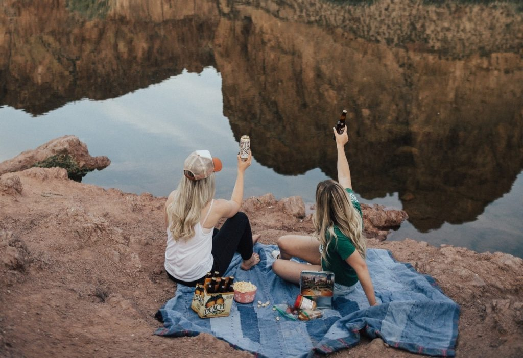 People Having Picnic on the Rocks | Breast Cancer Car Donations