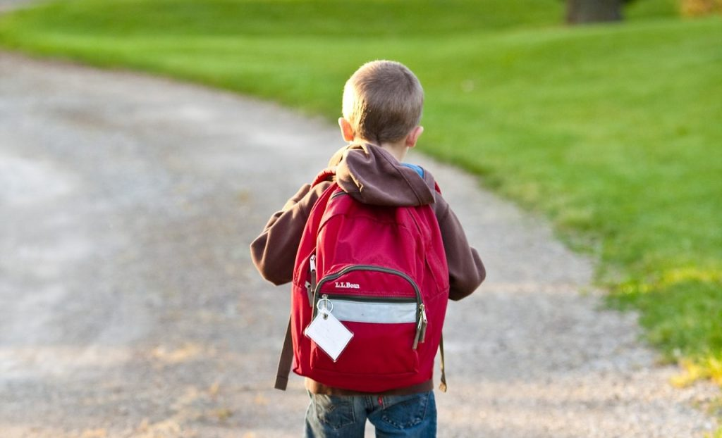 Kid Walking With his Backpack | Breast Cancer Car Donations