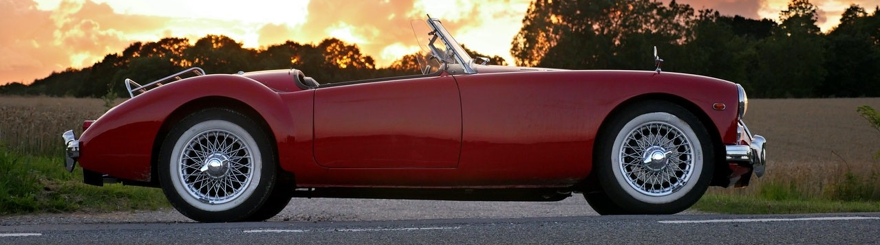 Red Classic Car in Sunset | Breast Cancer Car Donations
