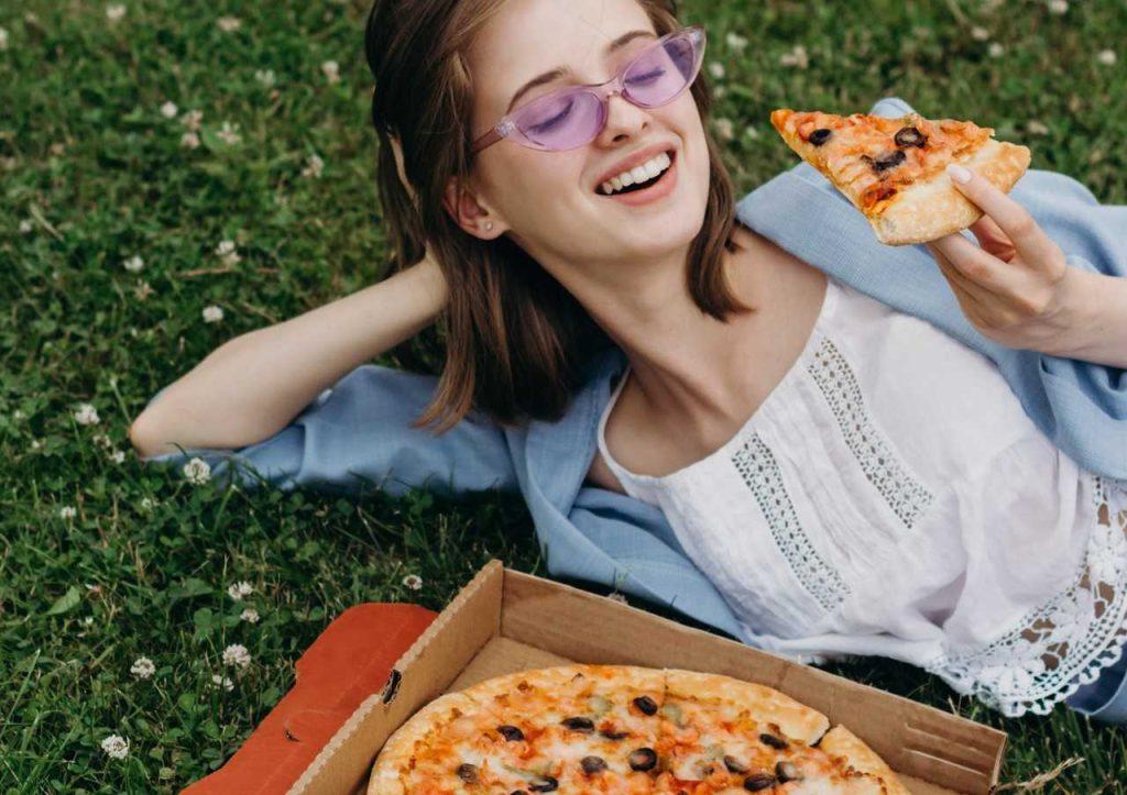 Woman Enjoying Box of Pizza   Breast Cancer Car Donations