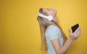 Woman Enjoys Music | Breast Cancer Car Donations