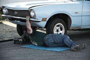 Mechanic Fixing Car   Breast Cancer Car Donations