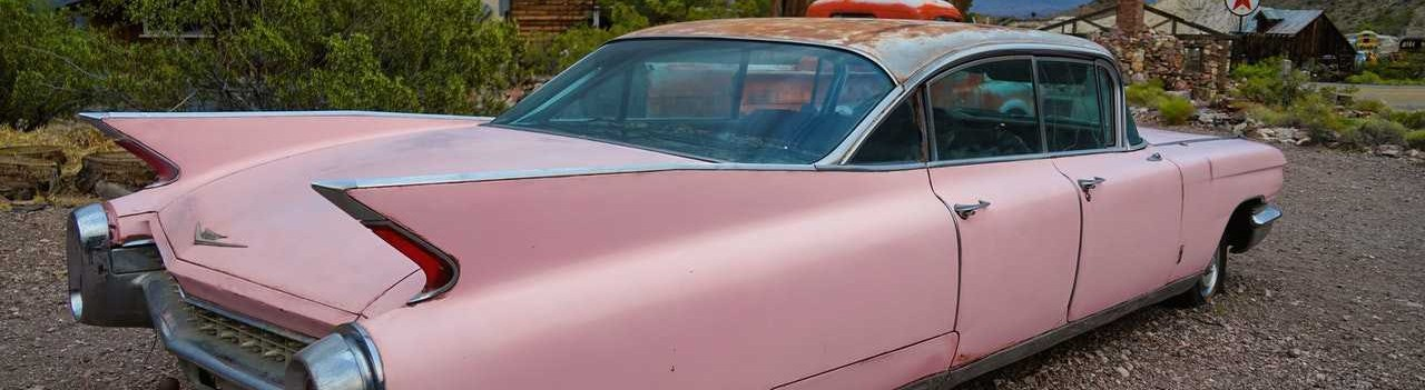 Old Pink Coupe Parked | Breast Cancer Car Donations