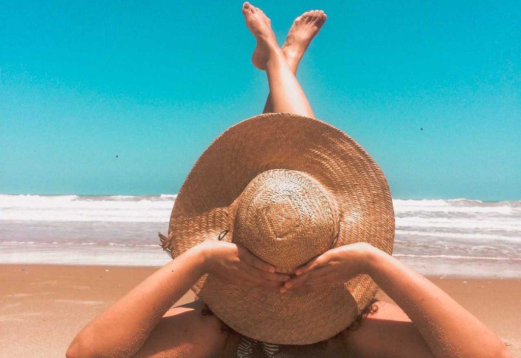 Woman Lying on a Beach Sand   Breast Cancer Car Donations